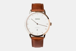 Rose gold case, brown leather strap