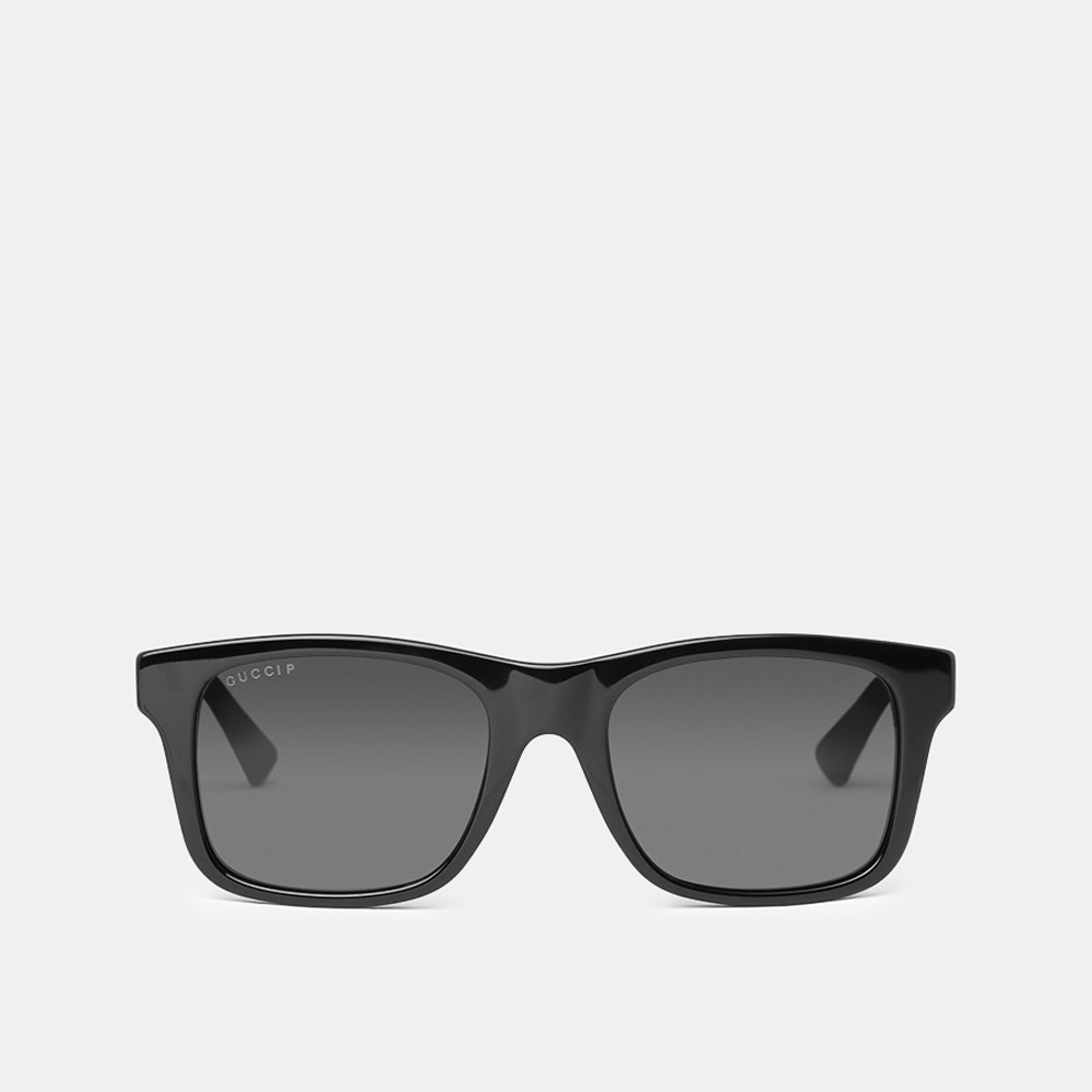 Gucci Polarized Rectangular Sunglasses The Height of Luxury -- The Gucci name has been synonymous with luxury for nearly a century. Evoke its classic, elegant style with these sunglasses, which feature a full-rim glossy black acetate frame and a universally flattering rectangular shape. The rubberized arms boast Gucci's fabric logo, and the polarized C39 lenses provide UV protection with enhanced color and contrast.
