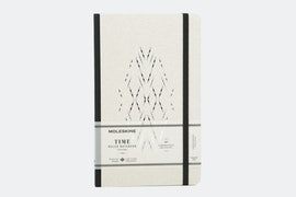 Black cover with ruled paper