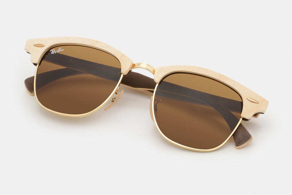 8a93c055c48 These shades take a shape popularized in the 1950s and update it with a  maple wood brow bar and arms. Gold metal accents and adjustable nose pads  complete ...