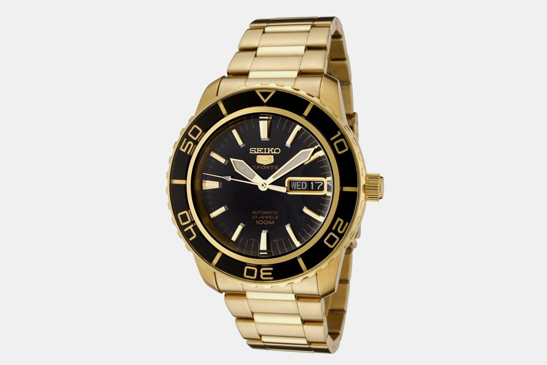 SNZH60K1 | Gold Case, Black Dial, Black Bezel (+$25)
